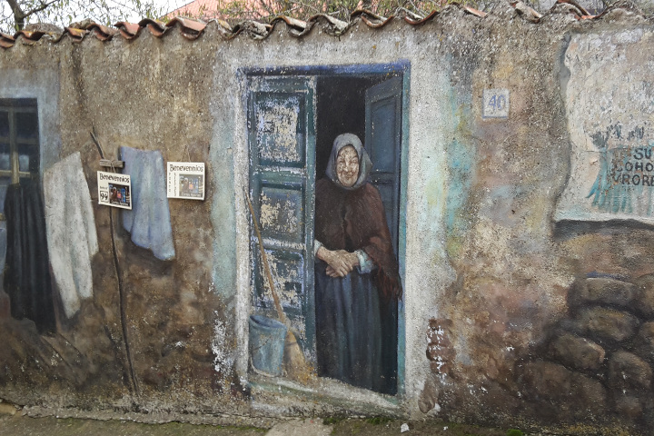 Murales of an old woman in Fonni